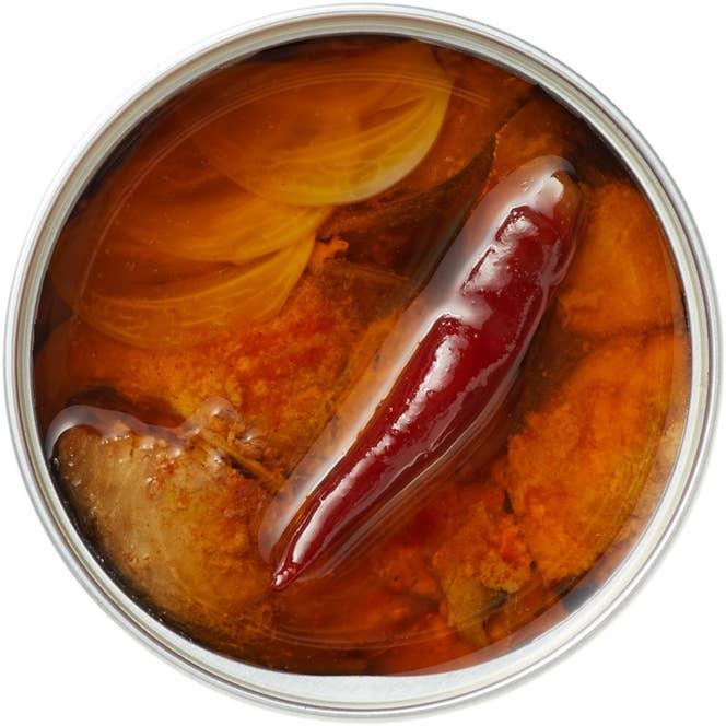 ガーリックオイル仕立ては、奥深い辛味がサバの味わいを引き立てる